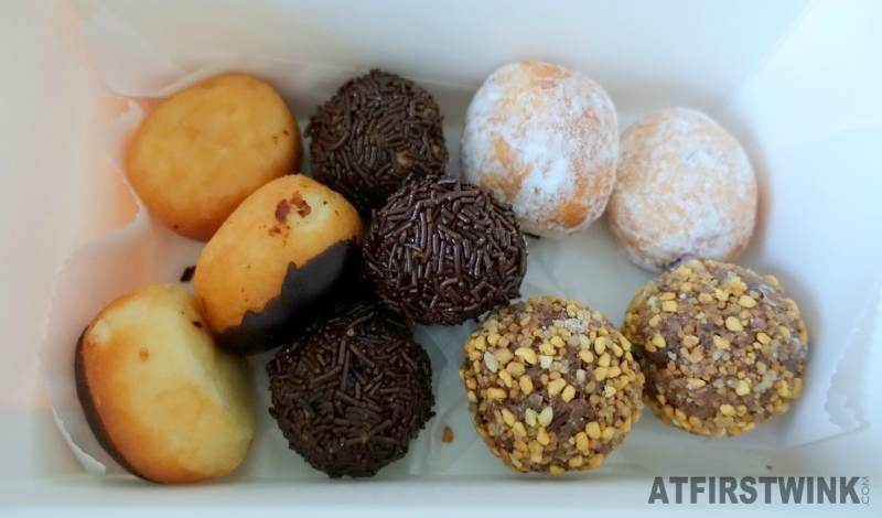 Dunkin' Donuts Netherlands a box of ten munchkins boston creme raspberry truffle hazelnut chocolate