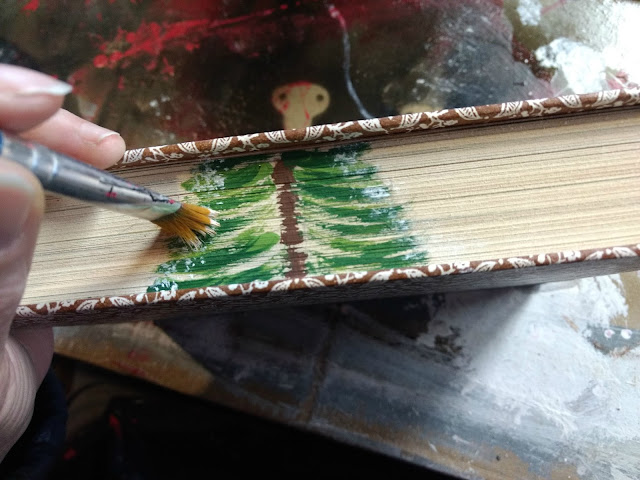 paint a pine tree on thrift store books
