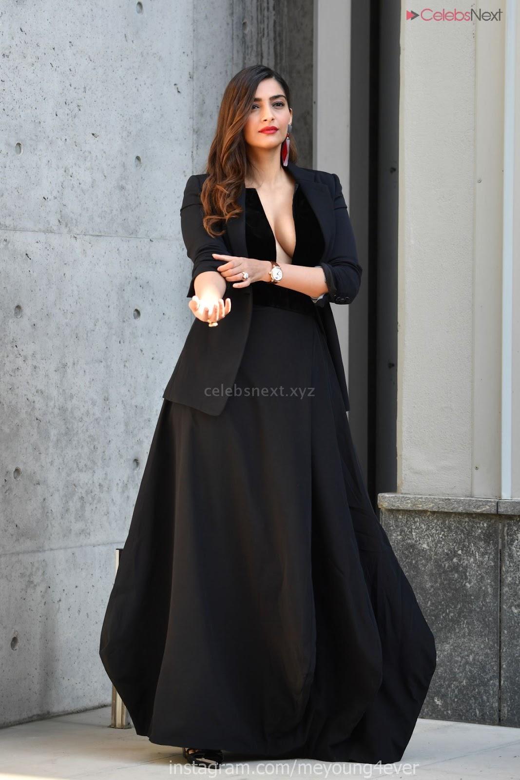 Sonam Kapoor looks ravishing in Black deep neck gown with her husband