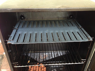 grease drain pan fits perfectly in the smoker