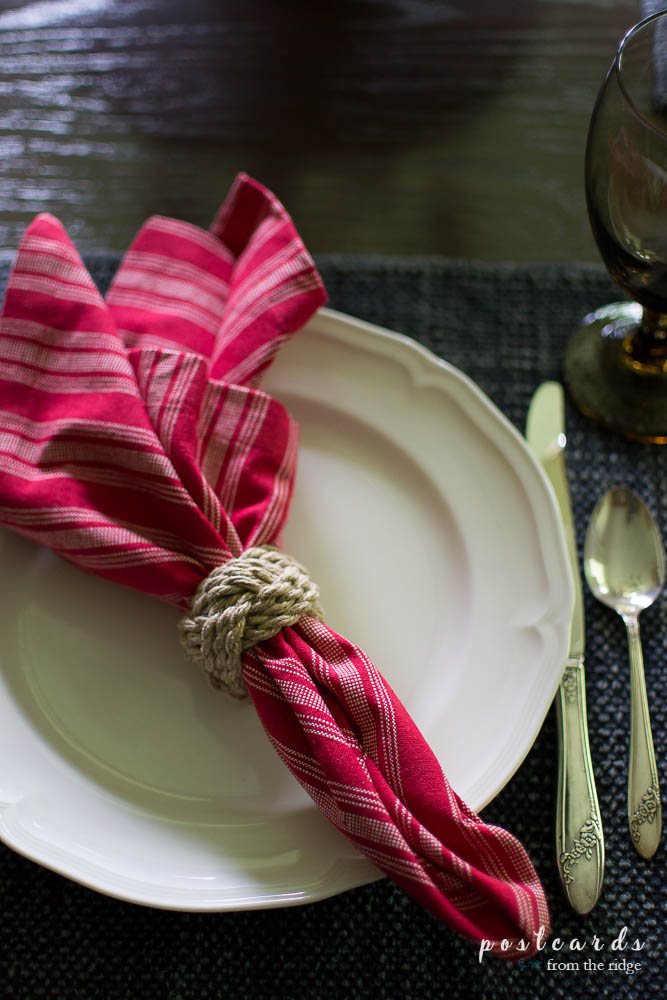 red striped napkin on a white plate and blue stonewashed placemat