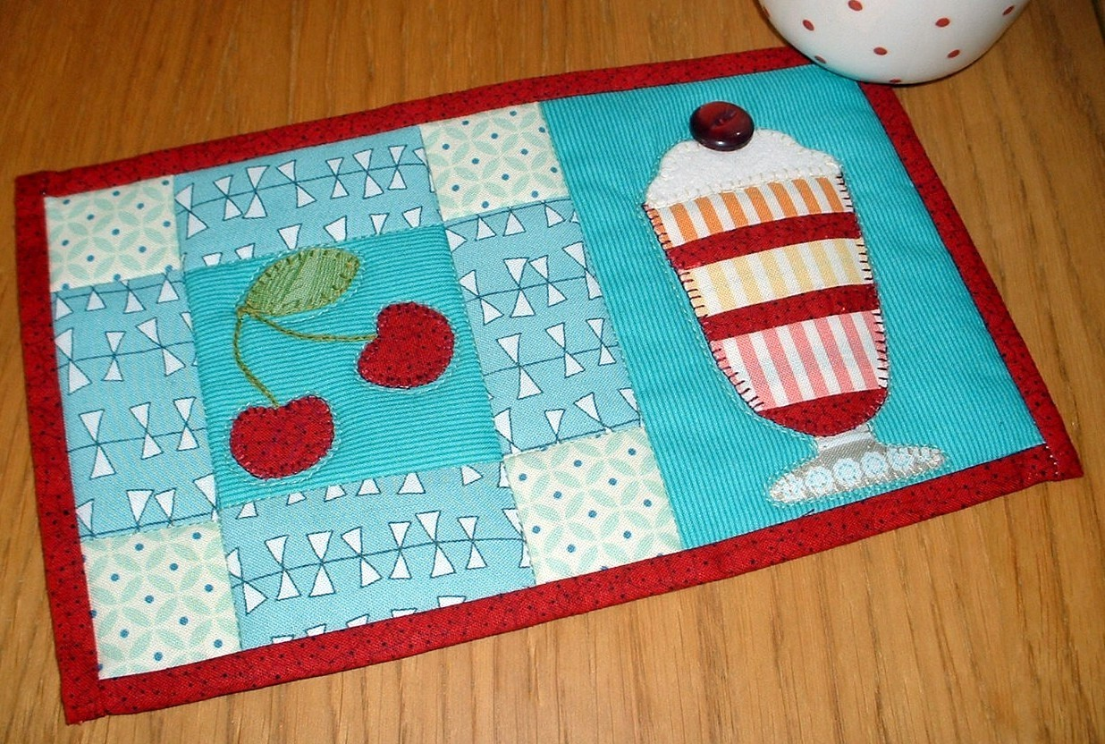 http://www.craftsy.com/pattern/quilting/home-decor/ice-cream-sundae-mug-rug/55562