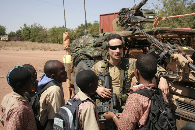 Image Attribute: A French Soldier talking with Malian Children / Source: Wikimedia Commons