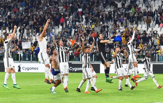 Juventus players celebrate with their fans
