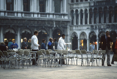 two waiters serving coffee in Piazza San Marco.
