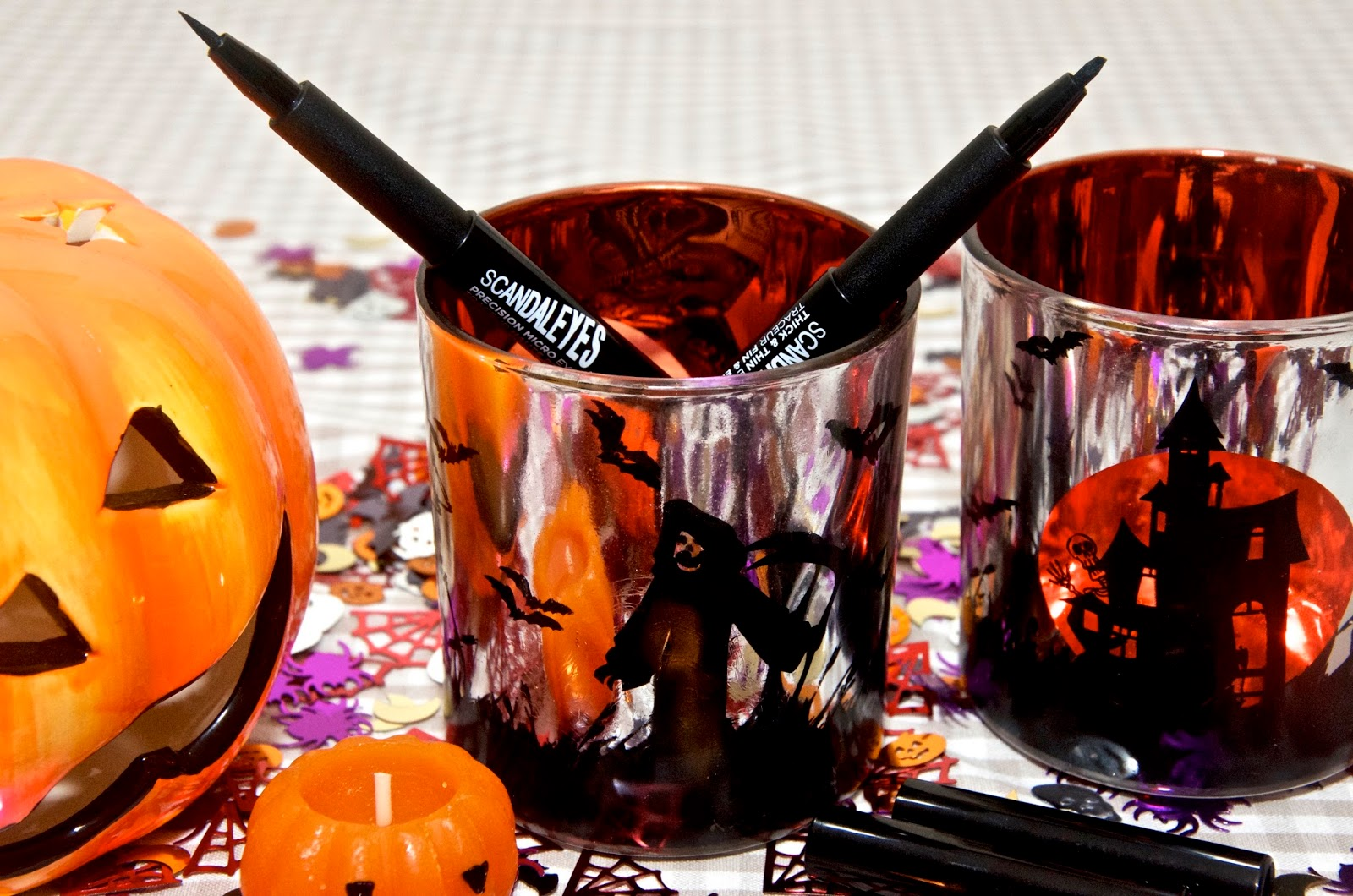 Two Eyeliner Pens in Halloween Votive Holders with Pumpkins and confetti