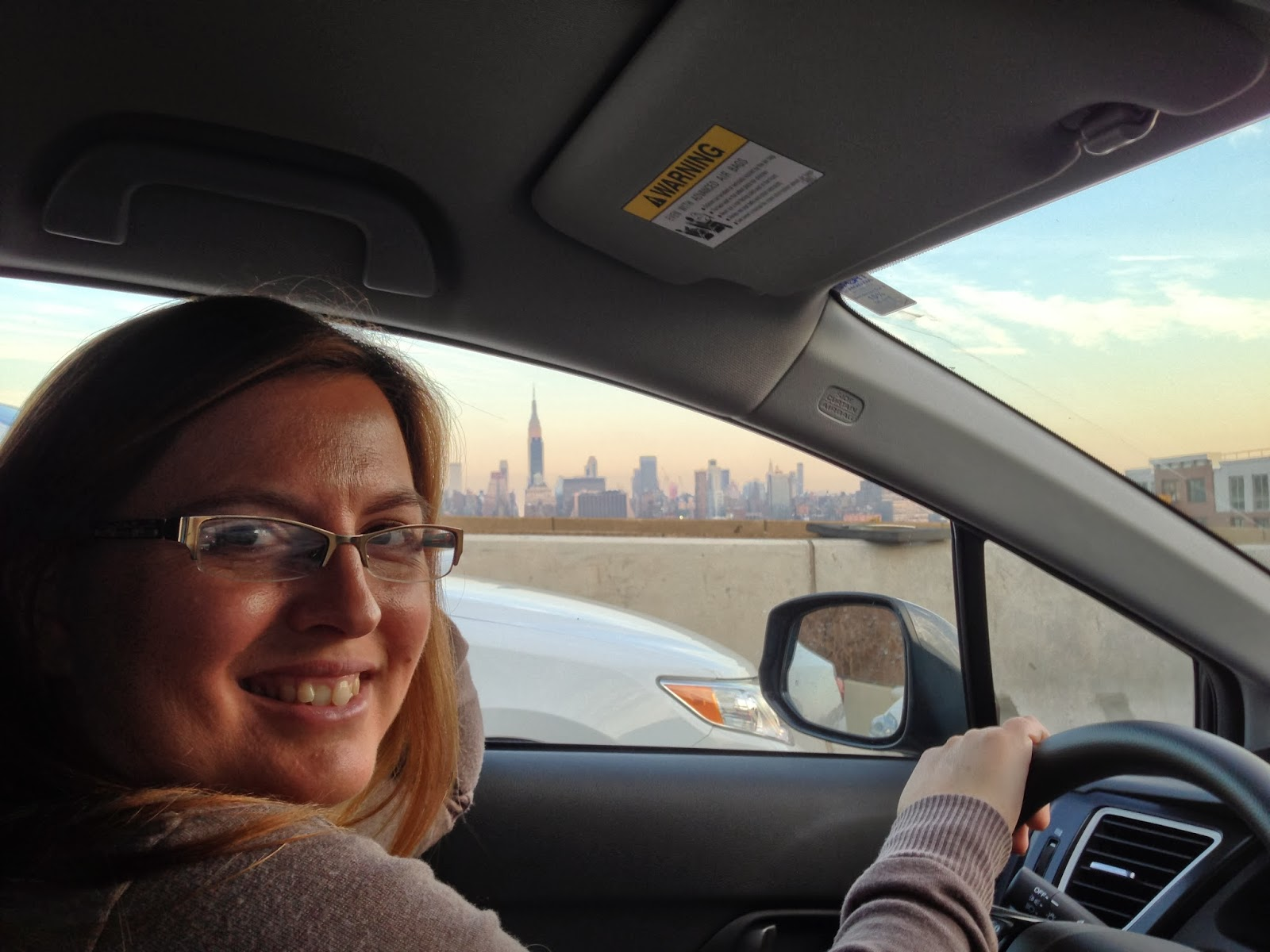 smiling woman, new york city skyline