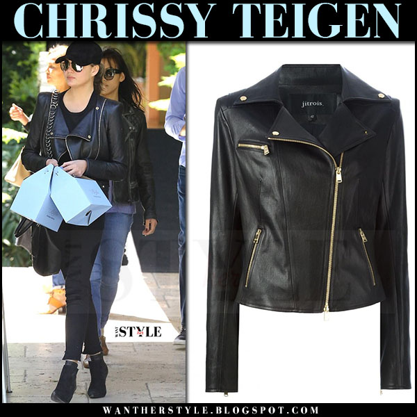 Chrissy Teigen in black biker jitrois jacket, black jeans and black ankle boots what she wore april 2017