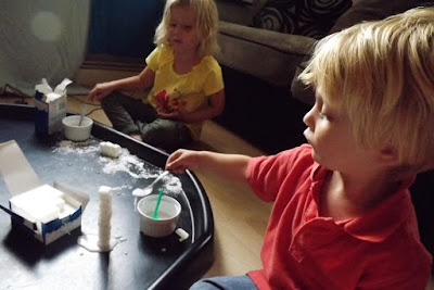 Messy construction play with sugar cubes and water icing
