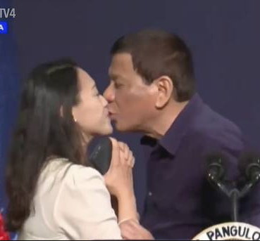 Philippines president Rodrigo Duterte sparks outrage for kissing woman on stage (video)