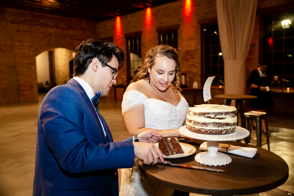 Couple sharing cakes together on their big day