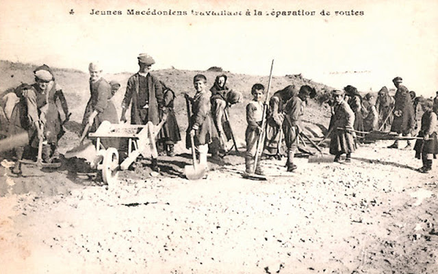 """The local population in Macedonia works on the """"French road"""" near village Skochivir, during the first world war."""