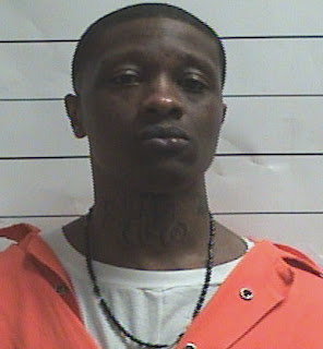 new orleans cop killer feces mouth head face