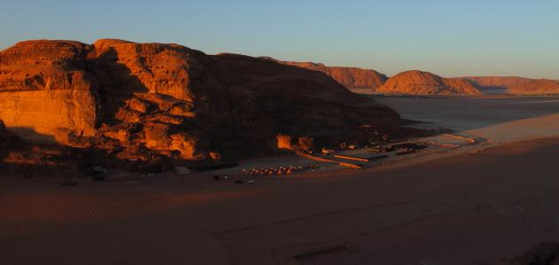 Setting sun casts a golden glow on the desert camps of Wadi Rum, Jordan
