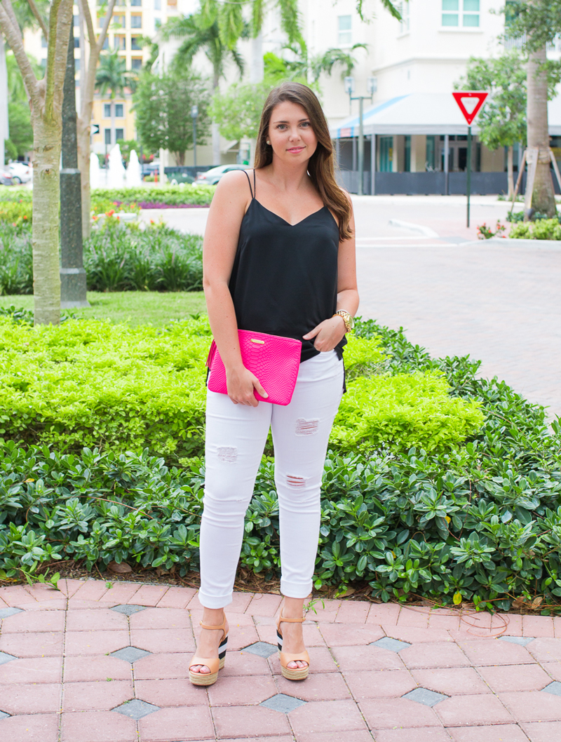 Black silk tank, white distressed skinny jeans, and colorful clutch for date night.