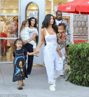 Kim K goes braless while out with her husband Kanye & their kids