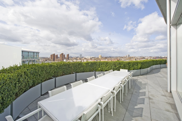 Picture of white large dining table on the terrace overlooking the city