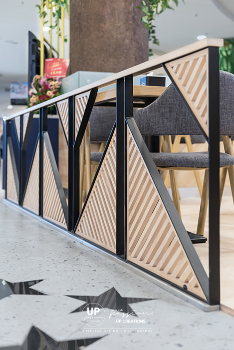 Sunway pyramid rasa royal kiosk with divider designed with wood strips in triangle black metal frame