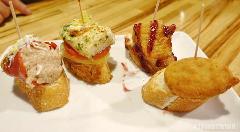 Pinchos and drinks in Barcelona Spain baguette toppings tuna pepper fried fish chicken