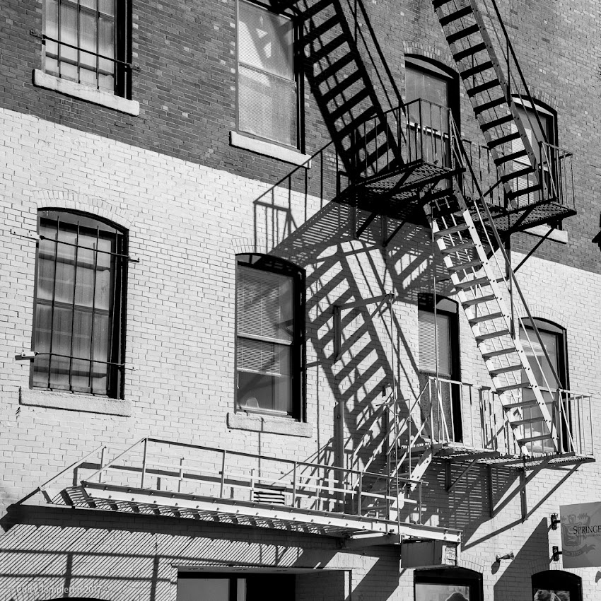 Portland, Maine USA June 2016 photo by Corey Templeton. Shadows always make me want to convert a photo to black and white. Here's a take on some fire escape on Free Street.