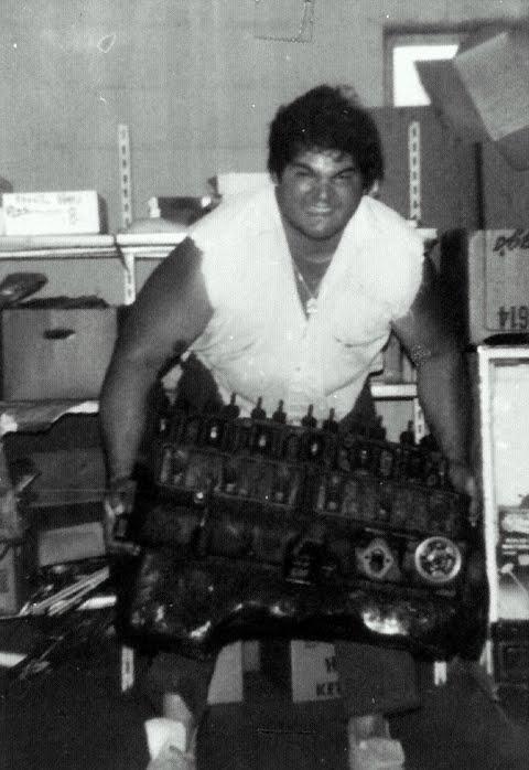 Isaac Nesser carrying a truck engine