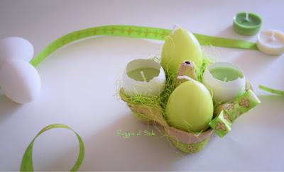 Centrotavola di primavera con candele nel guscio e candele a forma d'uovo