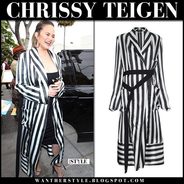 Chrissy Teigen in black and white striped coat and sandals yeezy model street style may 30