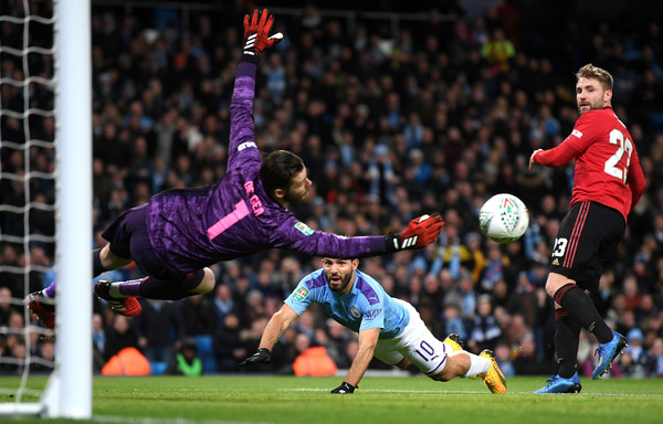 Sergio Aguero of Manchester City has a header saved by David De Gea of Manchester United during the Carabao Cup Semi Final match between Manchester City and Manchester United at Etihad Stadium on January 29, 2020 in Manchester, England