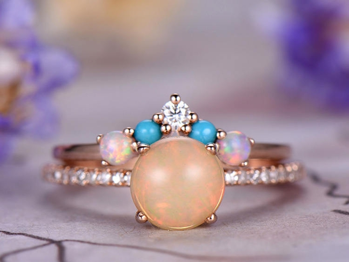 https://www.bbbgem.com/7mm-round-cut-african-opal-engagement-ring-set-14k-rose-gold-turquoise-band-half-eternity-curved-band-pave-set-anniversary-ring-gift-for-her/