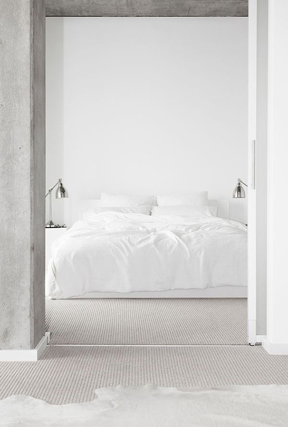 High-impact things to hang over your headboard | Empty wall. Minimalist bedroom design. Photo by Jaclyn Campanaro