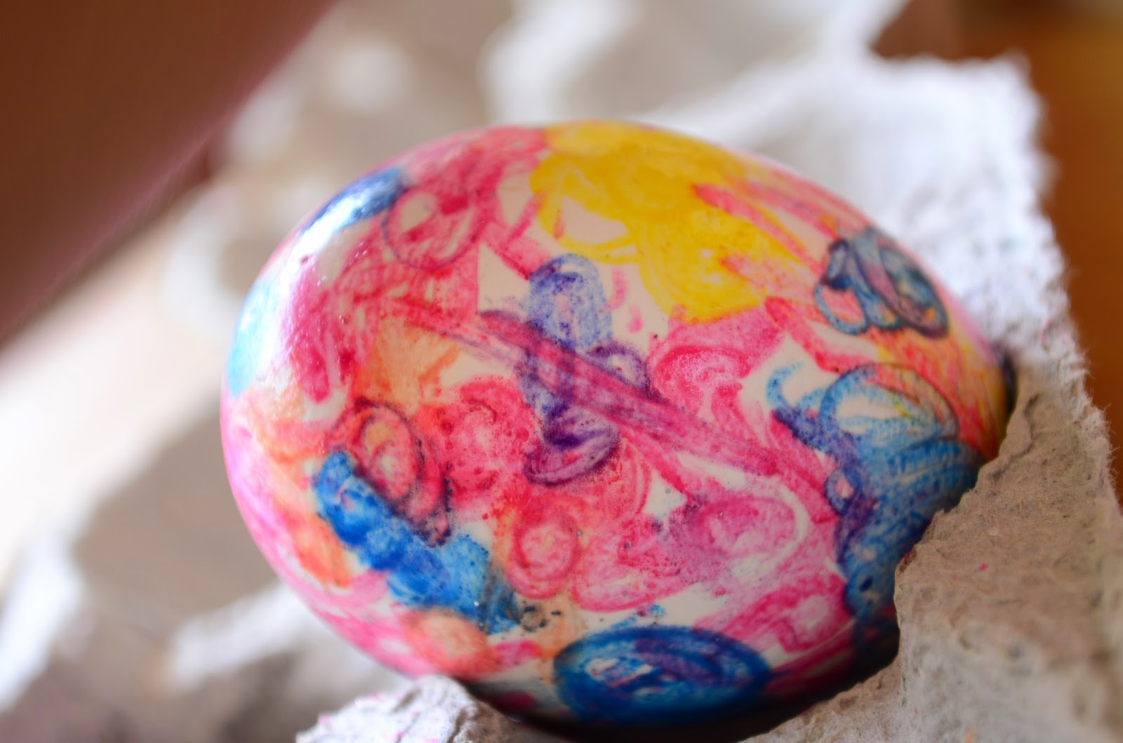 Decorate Easter Eggs with pink, purple, yellow, and blue