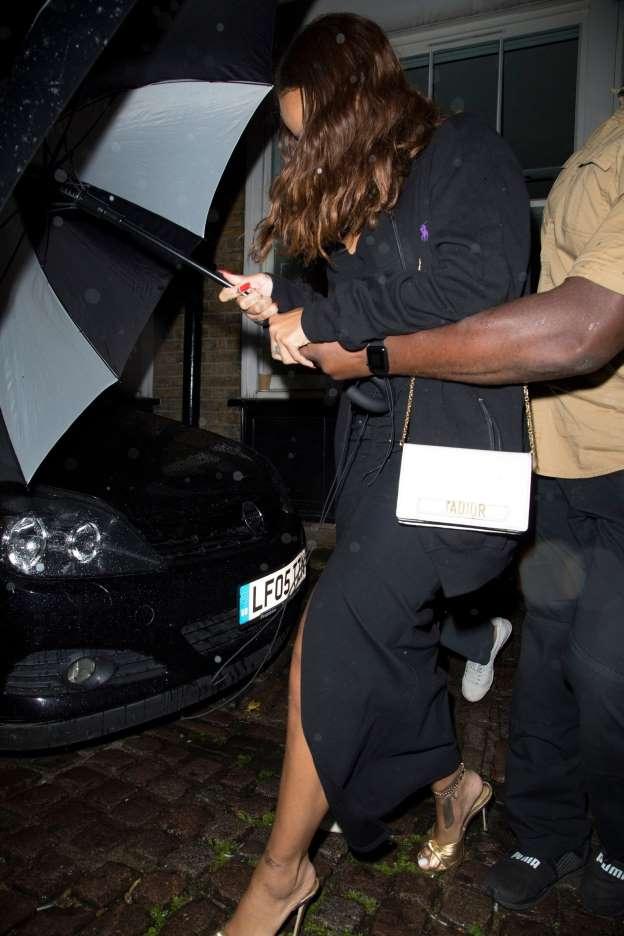 Rihanna Attempts to Hide Her Boyfriend Under Her Umbrella