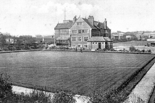 Early photograph of the Institute with the Bowling Green in the foreground.
