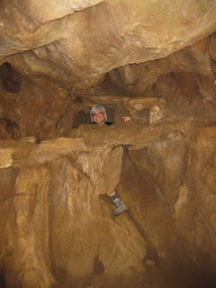 pep inside a formation in the Lake Shasta Caverns, Lake Shasta, California
