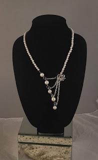 https://www.amazon.in/gp/search/ref=as_li_qf_sp_sr_il_tl?ie=UTF8&tag=fashion066e-21&keywords=pearls  with gold chain&index=aps&camp=3638&creative=24630&linkCode=xm2&linkId=022e78492944ab36aeaf03bc5e30fcb8