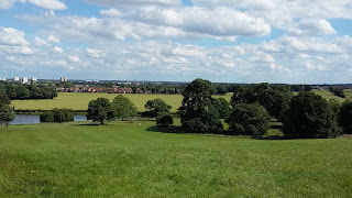 Picture of meadows and lake down in the valley below Cusworth Hall.