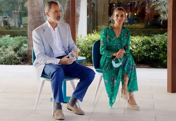Queen Letizia wore a floral print dress by Maje, and a suede shoes Mint and Rose