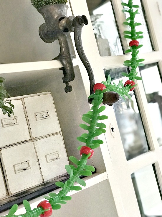 Recycled and repurposed applesauce top garland