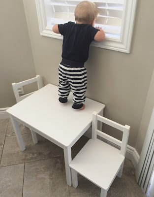 should my 10 month old be crawling on tables?
