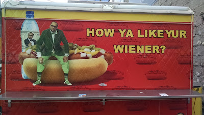"Man sitting on giant hot dog. Caption: ""How ya like yur wiener?"""