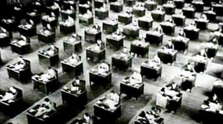 An endless stream of desks from King Vidor's 1928 film The Crowd.