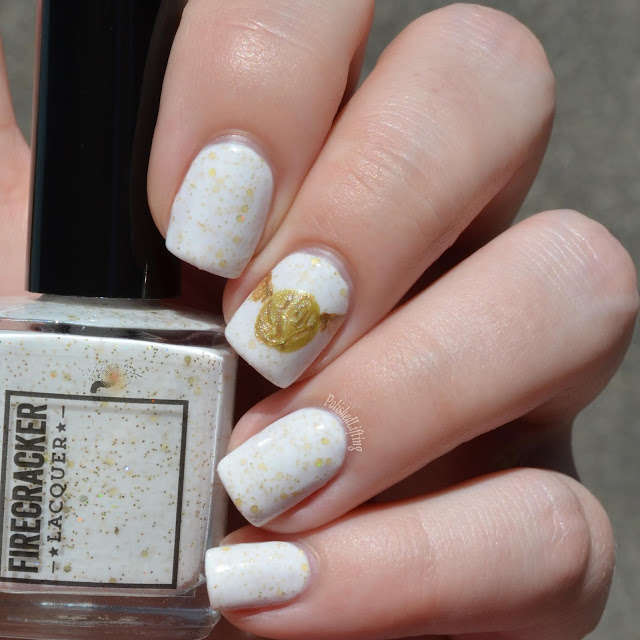 white nail polish with gold glitter