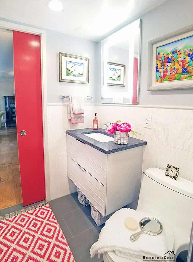 Fuchsia pocket door in bathroom