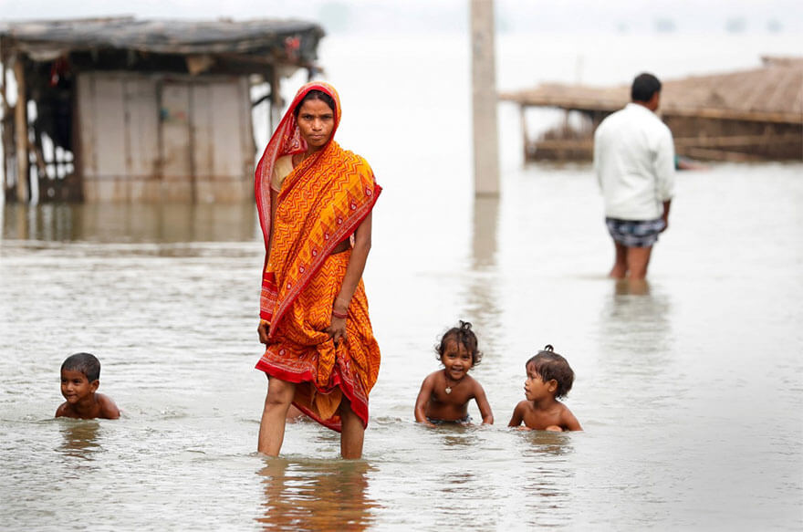 18 Devastating Pictures Of The Flooding In South Asia That Will Shock You - A Woman Walks Through A Flooded Village In Motihari, Bihar State, India
