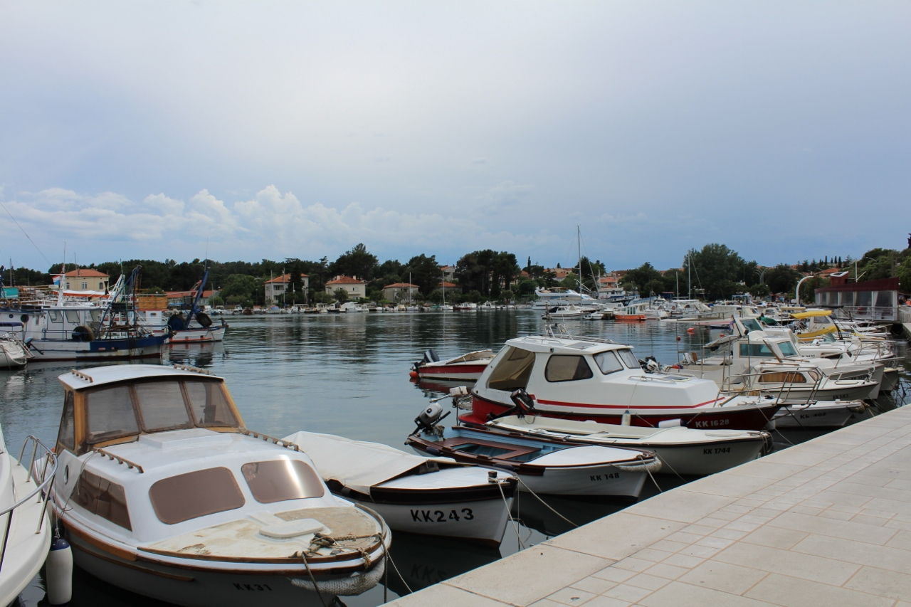 Boats moored at Krk Harbour in Krk, Croatia