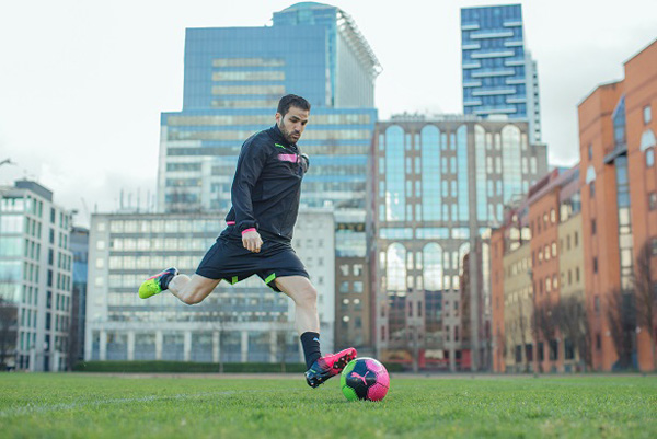 1718ea1e3 Cesc Fàbregas in action wearing the dual coloured Tricks boot by PUMA
