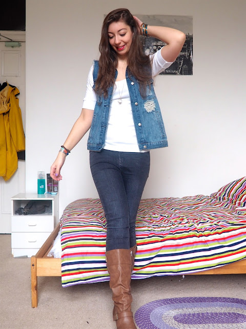 Flynn Rider Tangled Disneybound outfit - blue denim waistcoat, white top, grey skinny jeans and brown leather high heeled boots