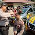 Kapolres Bangkalan Lakukan Penyiraman Simbolis Saat Penyerahan Mobil Dinas Baru