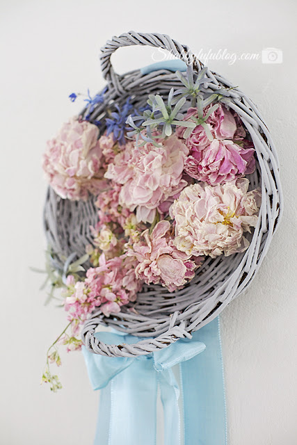 This floral peony wreath was made with some fresh peony flowers, an old white-washed wicker basket, and some hot glue! Such a simple project.