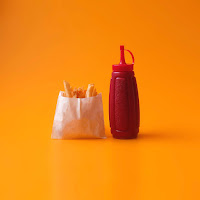 ketchup fries Photo by Miguel Andrade on Unsplash